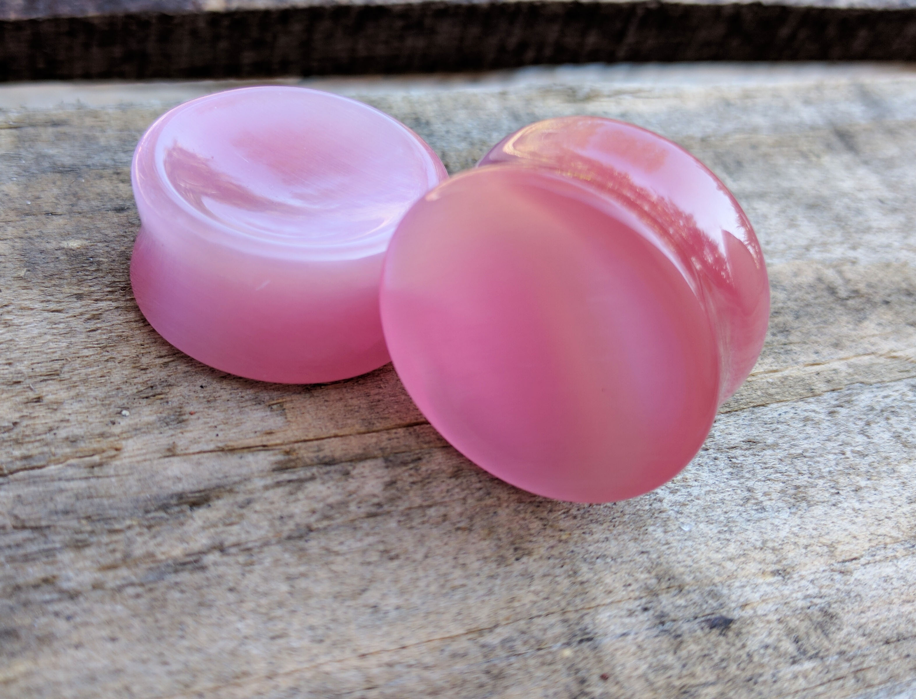 Pink Cats Eye Concave Double Flared Plugs